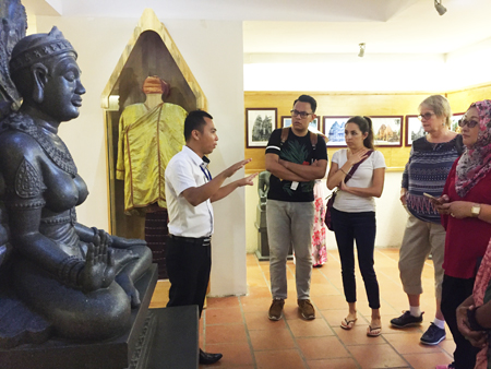 Tour guide introducing legend of Ponagar Goddess to delegates.