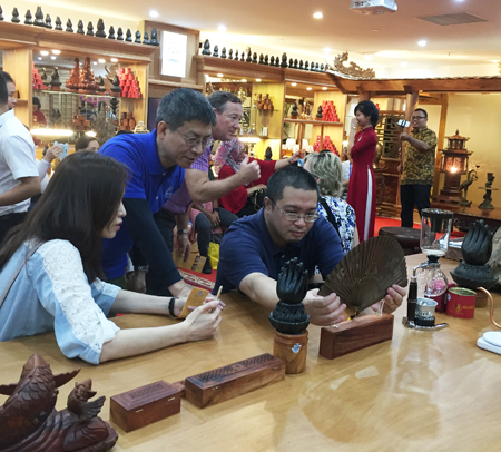 Contemplating products made of agarwood.