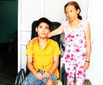 A young man with paraplegia needs help