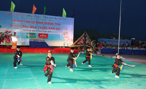 Performing traditional martial art.