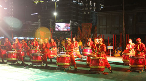Performing with drums.