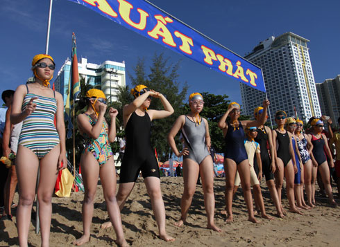 Female competitors get ready for swimming event.