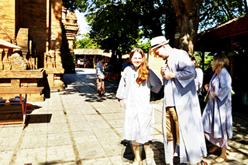 Foreign tourist wearing long robes before entering temples at Ponagar Temple.