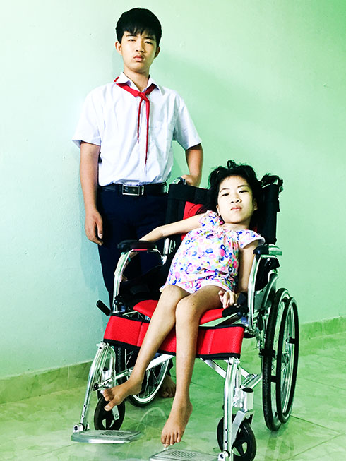 Phan Nhat Truong and his younger sister