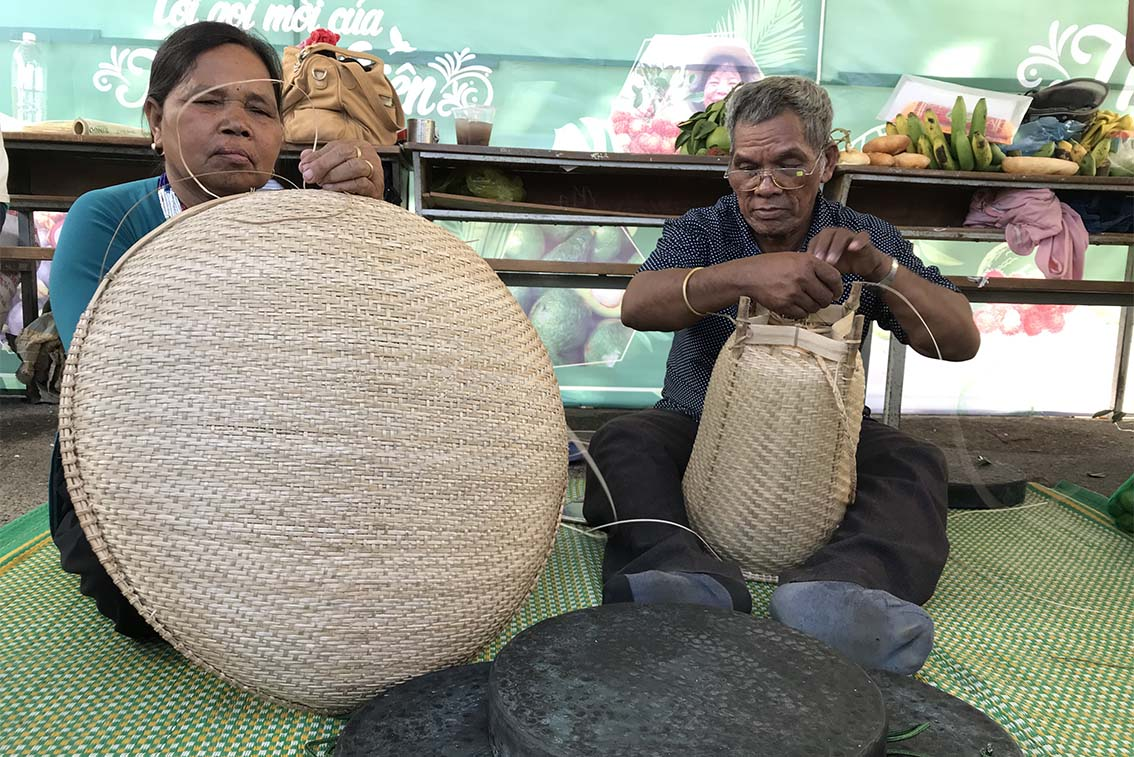 People from Son Lam Commune making flat basket and papoose