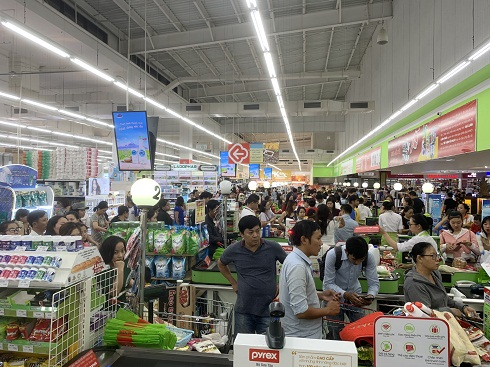 Lines of customers waiting to pay at checkout counters at Big C Supermarket