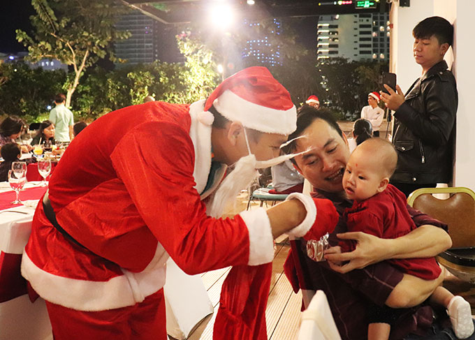 Santa Claus offering Christmas gift to a child