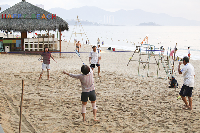 Playing badminton on beach