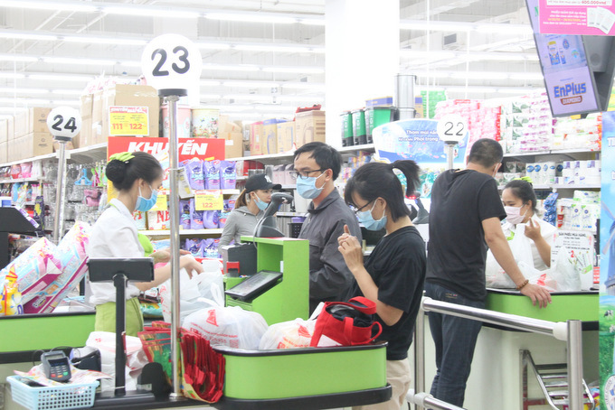 Many people go shopping at supermarkets instead of markets