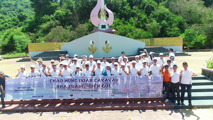"Caravan group posing for photo at ""No-number"" Ship Monument in Vung Ro, Phu Yen Province"