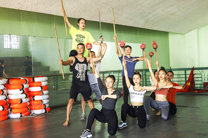 Artists of Hai Dang Song and Dance Troupe practicing in head office's attic room
