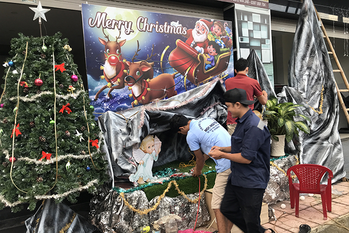 Setting up Nativity scene at a parish in Dien Khanh District