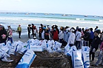 Over 200 people join beach clean-up on Green Environment Day