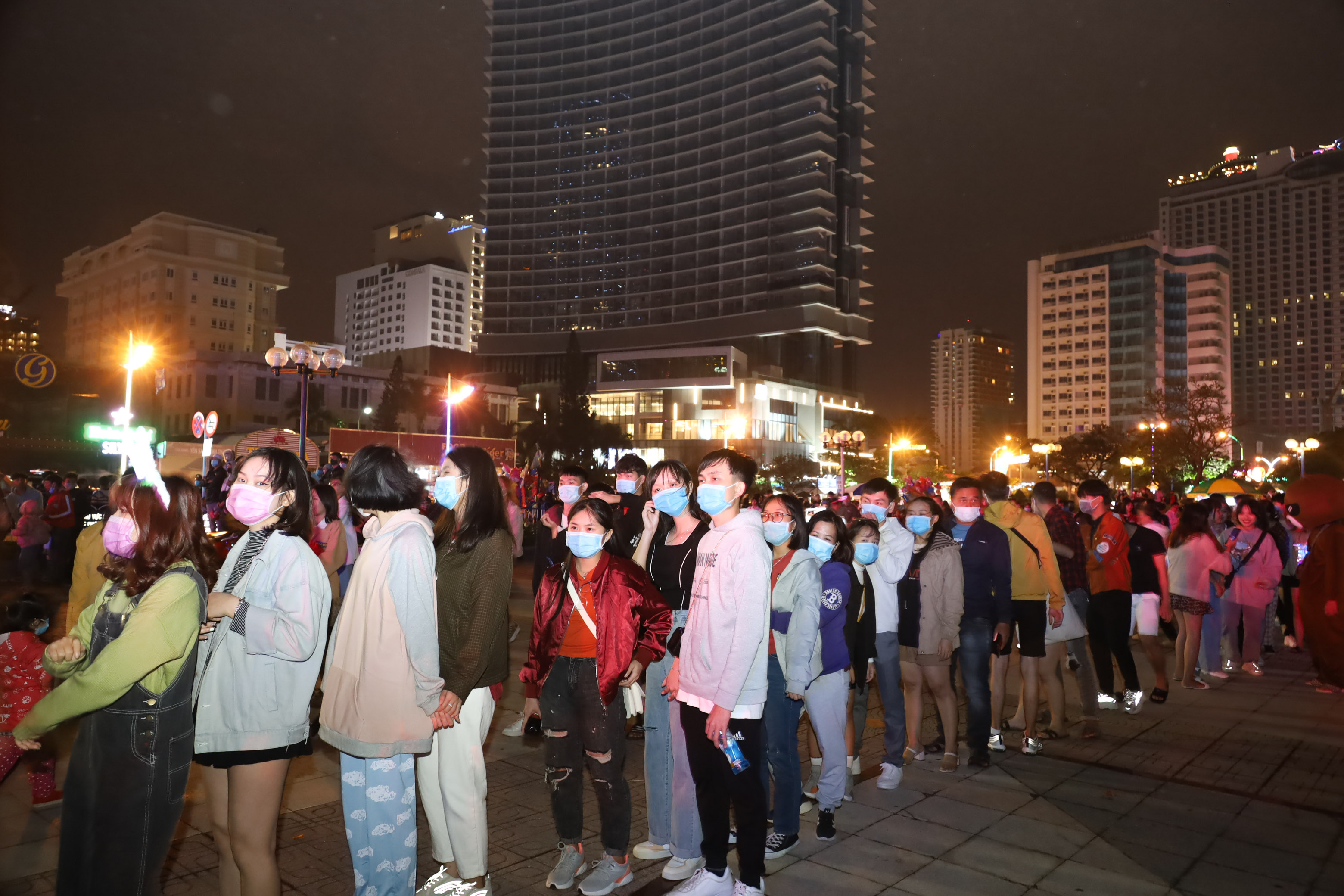 Queue of people waiting to get into music show area