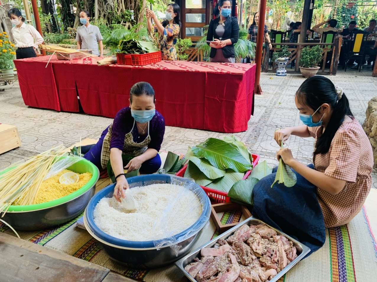 The hotel prepares ingredients to make Banh Chung including glutinous rice, mung beans, pork, and dong leaves