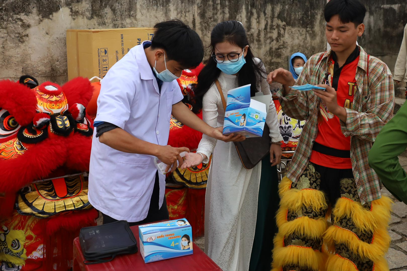 Participants wear masks and wash hands with hand sanitizer