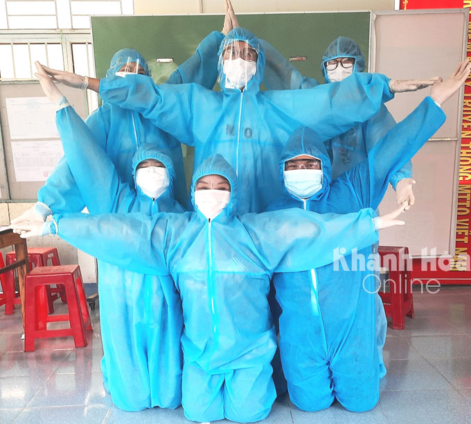 Volunteers do star pose to show their determination in helping the country contain the outbreak