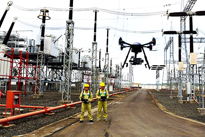 Technicians using drones to observe grid